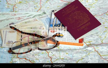 May 2019 - Travel concept, map, passport, guide book money & Glasses. - Stock Photo