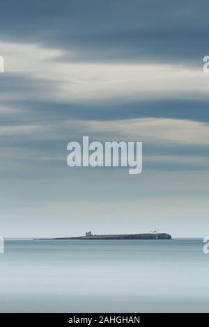 Farne Island from Bamburgh beach, Northumberland, a long exposure. - Stock Photo