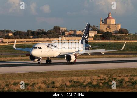 Airbus A320-200 jet plane in the new colours of German airline Lufthansa on the runway after landing at Malta airport. Air travel in the EU. - Stock Photo