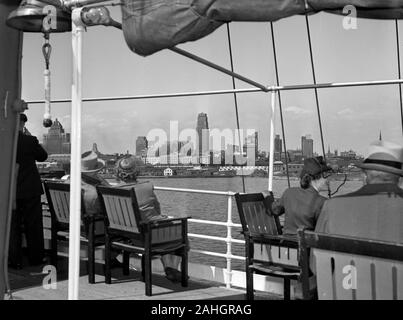 Passengers view the Toronto skyline from the deck of the passenger liner S.S. North America, 1942 - Stock Photo
