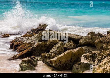 Waves crashing on a tropical beach in Barbados - Stock Photo