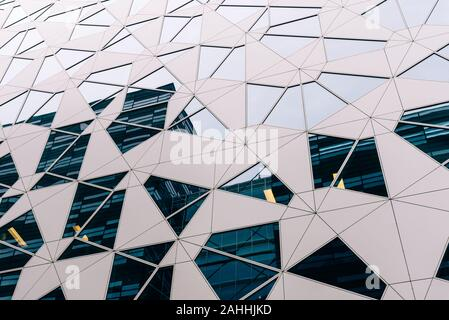Oslo, Norway - August 11, 2019: Low angle view of modern curtain wall facade in Barcode Project area. - Stock Photo