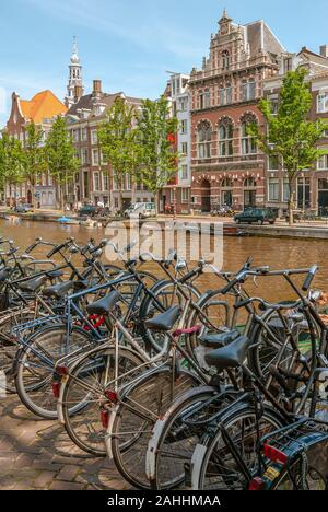 Bicycles parked on a gracht in the inner city of Amsterdam, Netherlands Stock Photo