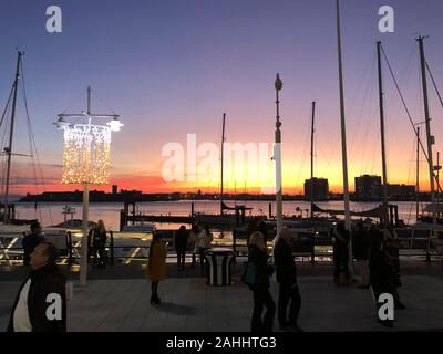 Sunset over the Solent at Portsmouth, Spinnaker Tower light up in Green. - Stock Photo