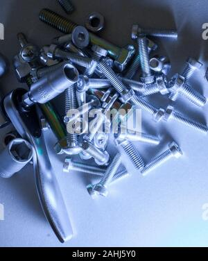 small ratchet with torx nut and many screws - Stock Photo