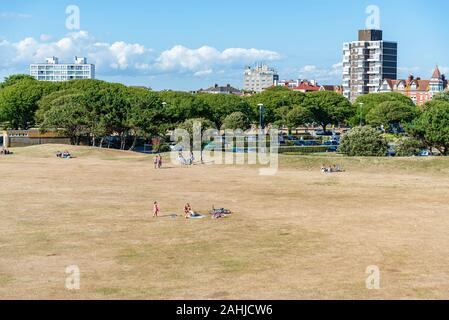 People enjoy the Castle field wide space in a sunny day in Portsmouth UK - Stock Photo