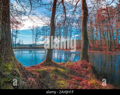 Sunday walk aorund a small lake with a small Wood erlenmoos, rot an der Rot Stock Photo