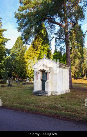 The small Montagu-Winch Mausoleum in South Cemetery, Brookwood Cemetery, Cemetery Pales, Brookwood, near Woking, Surrey, southeast England, UK - Stock Photo