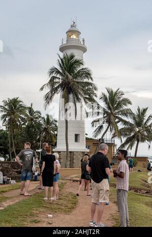 Galle, Sri Lanka. 2019 Nov 19 :  Tourist speack whit Guide in Galle Fort in Bay of Galle on southwest coast of Sri Lanka. - Stock Photo