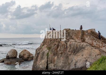 Galle, Sri Lanka. 2019 Nov 19 : People Visit the wall in Galle Fort in Bay of Galle on southwest coast of Sri Lanka. - Stock Photo