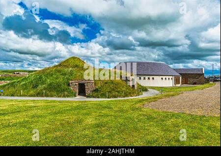The Skara Brae visitor centre and replica stone age house on Orkney mainland Scotland - Stock Photo