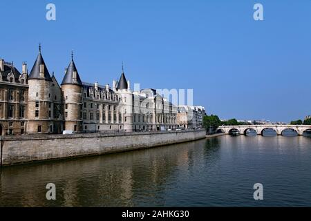 Paris, view along the River Seine with the medieval Conciergerie on the left hand side - Stock Photo