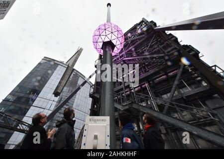 """The Times Square New Year's Eve Ball at 12 feet in diameter and weighing 11,875 lbs, covered with 2,688 """"Gift of Goodwill"""" designed Waterford Crystal triangles, is tested before the official Times Square Celebration in New York, NY, December 30, 2019. (Anthony Behar/Sipa USA) - Stock Photo"""