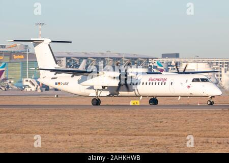 Stuttgart, Germany - December 30, 2019: Eurowings Bombardier Dash 8 airplane at Stuttgart airport (STR) in Germany. Bombardier is an aircraft manufact - Stock Photo