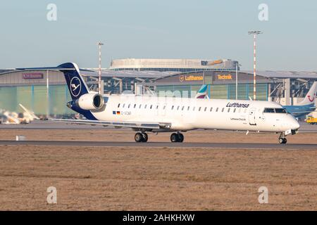 Stuttgart, Germany - December 30, 2019: Lufthansa Bombardier CRJ-900 airplane at Stuttgart airport (STR) in Germany. Bombardier is an aircraft manufac - Stock Photo