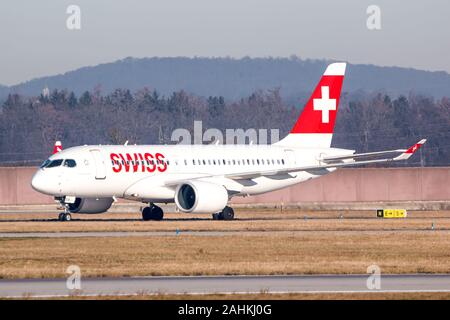 Stuttgart, Germany - December 30, 2019: Swiss International Airlines Airbus A220 airplane at Stuttgart airport (STR) in Germany. Airbus is an aircraft - Stock Photo