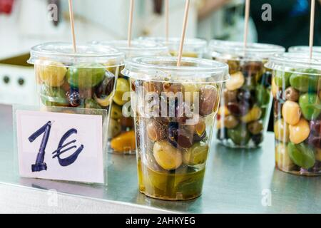 Valencia Spain Ciutat Vella old city historic district Mercat Central Central Market interior vendor stall stand shopping olives snack cup Spanish Eur