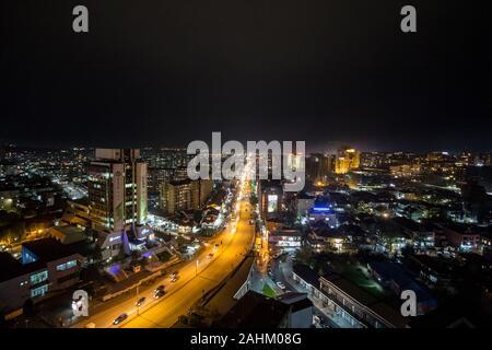 PRISHTINA, KOSOVO - NOVEMBER 11, 2016: Night view of the Bill Clinton Boulevard and George W Bush Boulevard in Prishtina with cars and heavy traffic p - Stock Photo
