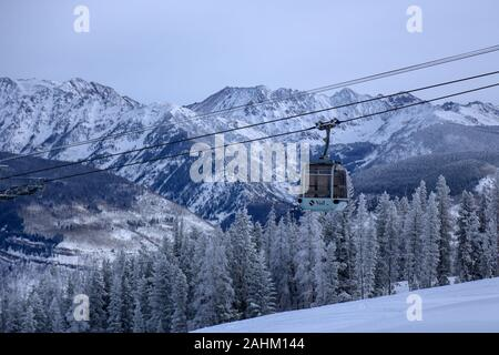 Gondola cable car at Vail Mountain Ski Resort in the snow covered Rocky Mountains on December 15, 2019 Vail, Colorado - Stock Photo