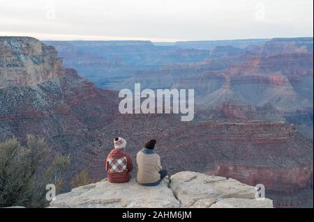 Couple enjoying the view over the Grand Canyon seen from the south rim - Stock Photo