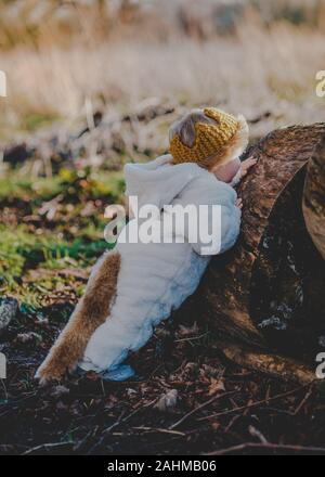 Little boy dressed as Max from Where The Wild Things Are in the woods