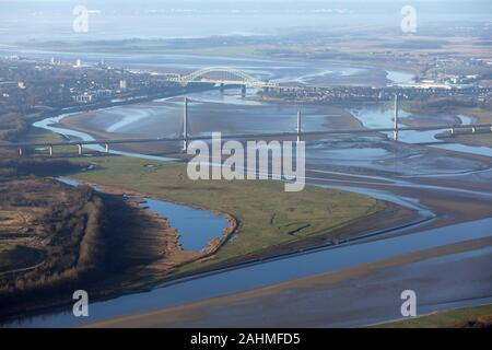 aerial view of the River Mersey at Runcorn with the Mersey Gateway Bridge and The Silver Jubilee Bridges prominent, Cheshire, UK - Stock Photo