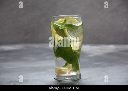 Water detox with lemon and fresh cucumber , on a dark background ,selective focus. Cold lemonade
