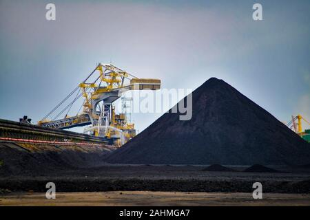 Coal Loaders Stack Piles Coal Ready for Export at Newcastle Australia - Stock Photo