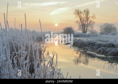 frosty sunrise over a tributary of the river adur in west sussex near partridge green - Stock Photo