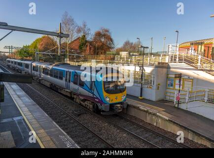 Trans Pennine express diesel train at Lea Green station in St. Helens. - Stock Photo