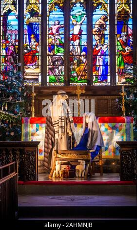 Nativity Scene in Halifax Minster at Christmas, West Yorkshire, UK. - Stock Photo