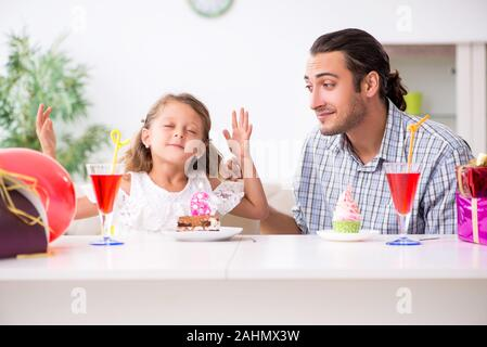 The father celebrating birthday with his daughter - Stock Photo