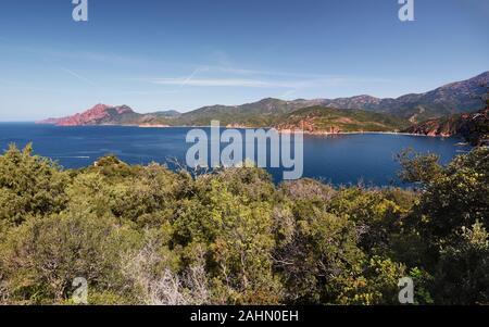 View of Porto Gulf in Corsica Mediterranean Sea Coastline, from Calanques de Piana, red cliffs of Scandola peninsula is at left background, Bay Porto, - Stock Photo