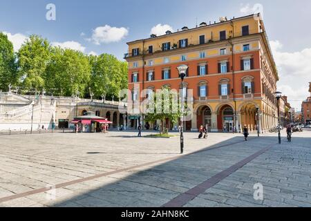 BOLOGNA, ITALY - JULY 10, 2019: People walk along XX Settembre or 20th September square in the city historic center with Pincio Staircase. Bologna is - Stock Photo