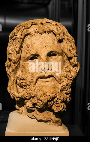 Egypt, Alexandria, Archeological museum of the Bibliotheca Alexandrina, head of the god Serapis, with his typical curly hair and beard. - Stock Photo
