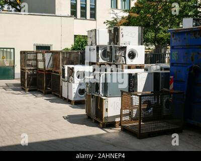 Wien/Austria - june 4 2019: discarded washing machines piled outside of a recycling and recovery compound in vienna - Stock Photo