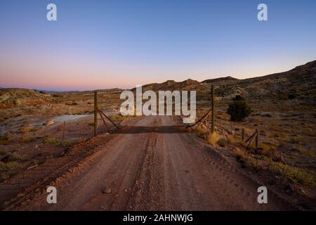 Driving Up to Cattle Guard On Dirt Road - Stock Photo