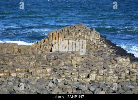 Giant's Causeway with stepping stones and basalt columns stretching out towards the sea, County Antrim, Northern Ireland, UK.