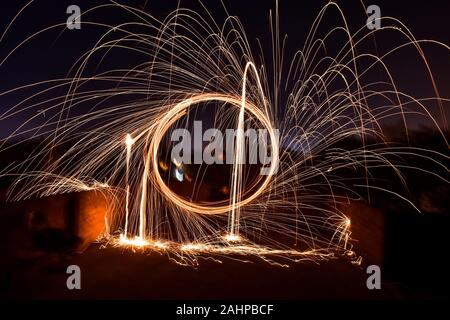 January 1, 2020, Rajpura, India: A boy spins a burning steel wool with a sling performing light painting during the New Year celebrations in Rajpura town. (Credit Image: © Saqib Majeed/SOPA Images via ZUMA Wire) - Stock Photo