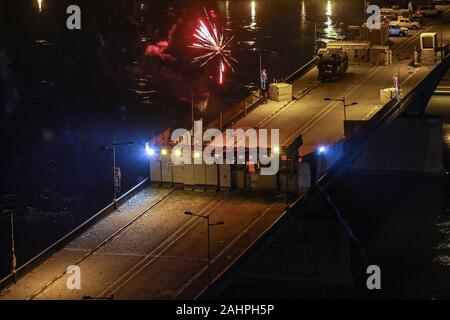 Baghdad, Iraq. 31st Dec, 2019. Fireworks burst above Al-Jumhuriya Bridge near Tahrir Square where people gathered to celebrate the 2020 New Year's Eve. Credit: Ameer Al Mohmmedaw/dpa/Alamy Live News - Stock Photo