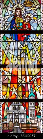 Stained-glass window depicting Our Lady of Tuchów Poland. The Sanctuary of Our Lady of Tylicz. - Stock Photo