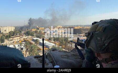 Baghdad, Iraq. 31st Dec, 2019. U.S. Army Soldiers from 1st Brigade, 25th Infantry Division, Task Force-Iraq, mans an observation post at Forward Operating Base Union III, in Baghdad, Iraq, on December 31, 2019. Dozens of angry Iraqi Shiite militia supporters broke into the U.S. Embassy compound in Baghdad on Tuesday after smashing a main door and setting fire to a reception area. Photo by Maj. Charlie Dietz/U.S. Army/UPI Credit: UPI/Alamy Live News - Stock Photo