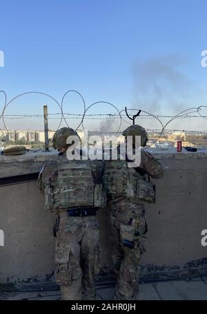 Baghdad, Iraq. 31st Dec, 2019. U.S. Army Soldiers from 1st Brigade, 25th Infantry Division, Task Force-Iraq, man an observation post at Forward Operating Base Union III, in Baghdad, Iraq, on December 31, 2019. Dozens of angry Iraqi Shiite militia supporters broke into the U.S. Embassy compound in Baghdad on Tuesday after smashing a main door and setting fire to a reception area. Photo by Maj. Charlie Dietz/U.S. Army/UPI Credit: UPI/Alamy Live News - Stock Photo