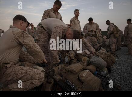Kuwait. 31st Dec, 2019. U.S. Marines assigned to Special Purpose Marine Air-Ground Task Force-Crisis Response-Central Command (SPMAFTF-CR-CC) 19.2, prepare to deploy from Kuwait in support of a crisis response mission in Baghdad, Iraq, on December 31, 2019. The SPMAGTF-CR-CC is designed to move with speed and precision to support operations throughout the Middle East. Photo by Sgt. Robert Gavaldon/U.S. Marine Corps/UPI Credit: UPI/Alamy Live News - Stock Photo