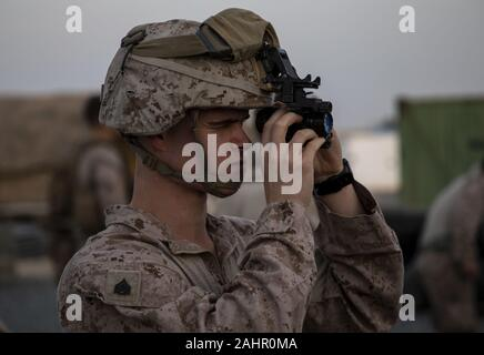 Kuwait. 31st Dec, 2019. A U.S. Marine assigned to Special Purpose Marine Air-Ground Task Force-Crisis Response-Central Command (SPMAFTF-CR-CC) 19.2, checks gear prior to deploying from Kuwait in support of a crisis response mission in Baghdad, Iraq, on December 31, 2019. The SPMAGTF-CR-CC is designed to move with speed and precision to support operations throughout the Middle East. Photo by Sgt. Robert Gavaldon/U.S. Marine Corps/UPI Credit: UPI/Alamy Live News - Stock Photo
