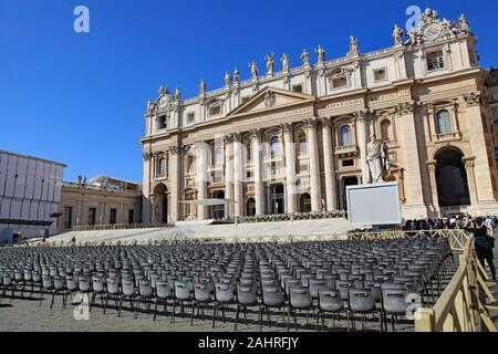 Empty chairs set up for a papal audience in front of St. Peter's Basilica, Vatican City, Rome