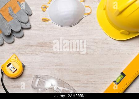 Yellow hardhat, gloves and hammer isolated - Stock Photo