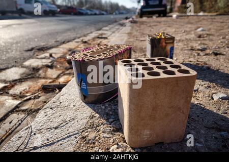 Nuremberg, Germany - January 01, 2020: The waste of the New Year's Eve fireworks with firework batteries is lying around in the streets of city on the - Stock Photo