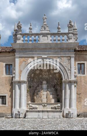 ancient Baroque San Lorenzo Certosa monumental stone fountain, shot in bright summer sun light at Padula, Salerno, Campania, Italy - Stock Photo