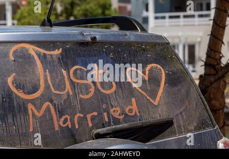 South Africa. December 2019. Just married sign with a heart painted on the rear window of a car. - Stock Photo